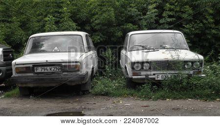 Kazahstan, Ust-Kamenogorsk, august 1, 2017: Two abandoned cars. Lada 1600 (Vaz 2106)