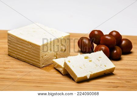 Telemea - Romanian cheese on wooden background
