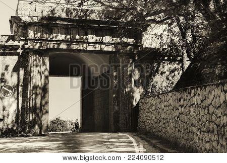 Baidar Gate In The Crimea, The Crimean Cultural Heritage, A Monument, A Bicyclist Stands Near The Ba