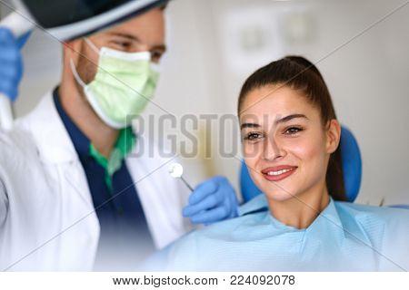 Beautiful young woman in dental ordination
