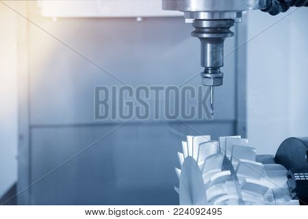 The 5-axis CNC machine cutting the sample part.The aero spaces part manufacturing process by 5-axis CNC machine.Modern manufacturing process.