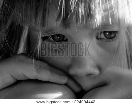 Sad child crying. Portrait of a little child with sad eyes