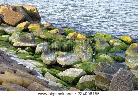 Warnemünde on the Baltic Sea in Germany Europe with stones in the foreground and shoreline with beach