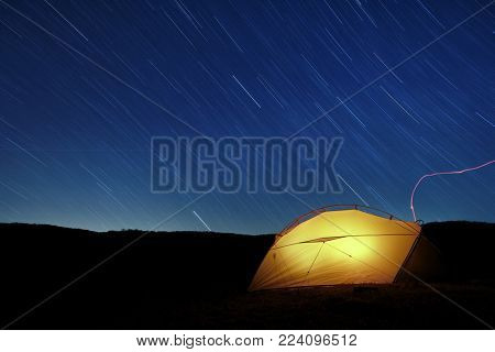 star trails on lighting tent in Nebrodi Park, Sicily