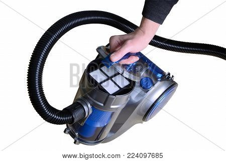 Man's hand opens the filter cover on the vacuum cleaner, isolated on white