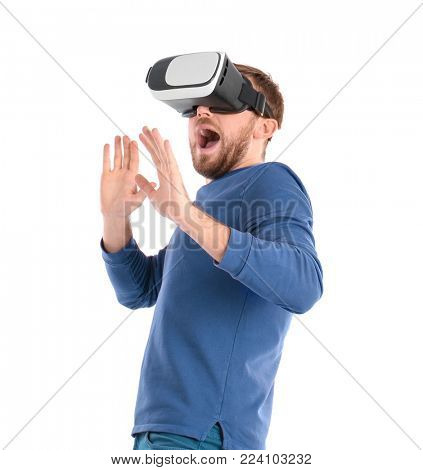 Emotional man with virtual reality headset on white background