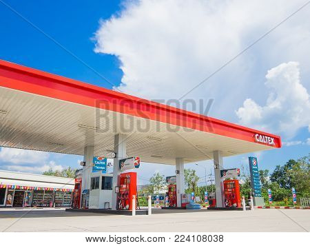 Trang, Thailand - September 2, 2017: Caltex gas station blue sky background. Caltex is a petroleum brand name of Chevron Corporation used in more than 60 countries.