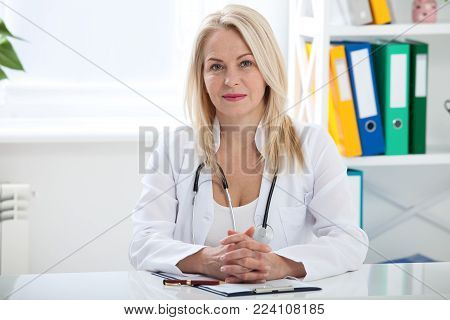 Doctor with stethoscope close up. Healthcare and medical concept - doctor with patient in hospital