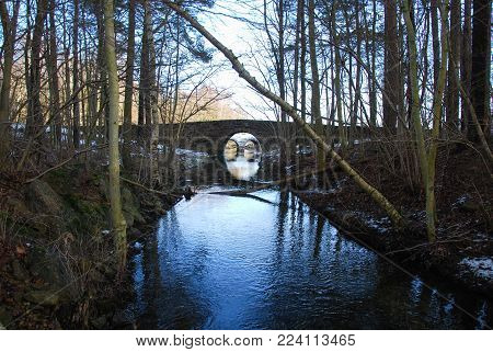 Old stone bridge by a small creek at the swedish island Oland