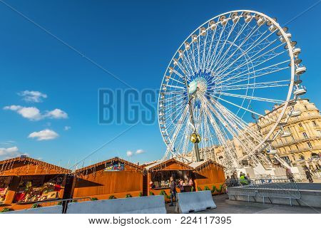 Marseille, France - December 4, 2016: Large Ferris wheel at square of old port of Marseille, Provence, France.