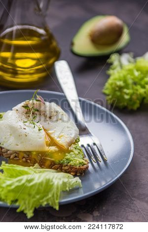 Sandwich With Avocado And Poached Egg. Healthy Breakfast