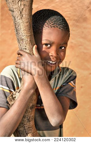 African boy in the yard of a village, Botswana