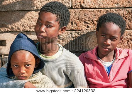 African brothers in front of the house in the village, Botswana