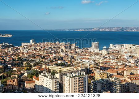 Marseille, France - December 4, 2016: Aerial panoramic view of Marseille from basilica of Notre Dame de la Garde for Cathedral de la Major in Marseille, Provence, France.