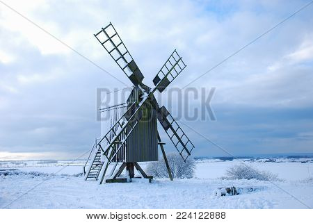 Old wooden windmill in a great landscape at winter season on the swedish island Oland