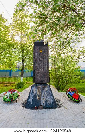 VELIKY NOVGOROD, RUSSIA-MAY 27,2017. Memorial stele at the Kolmovo memorial military cemetery. The brotherly cemetery of 167 Soviet soldiers who died in the war against the Nazis