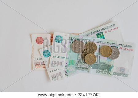 Money in Russia. Banknotes five and one thousand rubles, background, selective focus