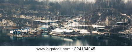 Panorama of the little workers industrial houses on the lake in the quarry, tilt-shift effect