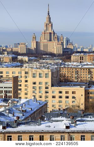 MOSCOW/ RUSSIA - JANUARY 25, 2017. View of the main building of Lomonosov Moscow State University, surrounded by the residential houses. Moscow, Russia.