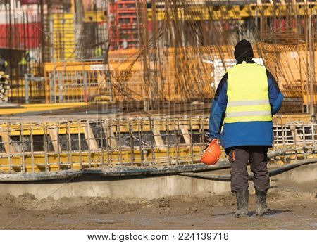 Builder ready to work at the construction site