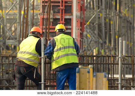 Two workers in yellow at the construction site