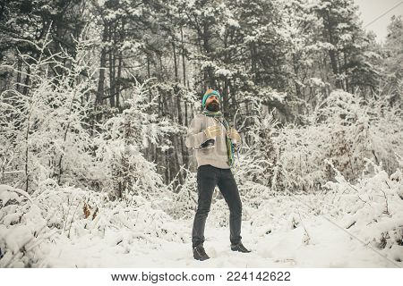 Winter Sport And Rest, Christmas. Bearded Man With Skates In Snowy Forest. Man In Thermal Jacket, Be