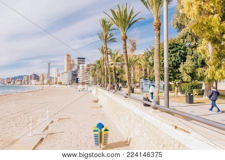 Benidorm, Spain - January 14, 2018: Benidorm Poniente beach and promenade, Benidorm, Costa Blanca, Spain