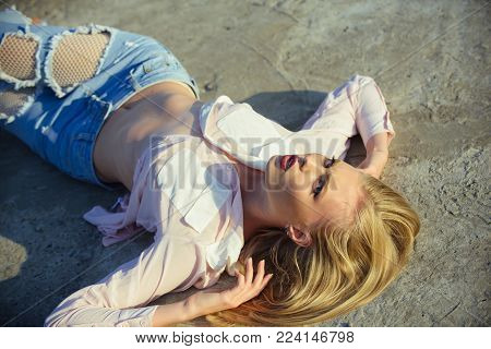 Fashion, Style, Trend. Sensual Woman With Sexy Belly, Fashion. Girl With Long Blond Hair Lie On Sunn