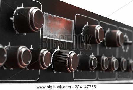 Front panel of amplifying electronic device close-up on a white background