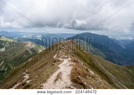 Blyst peak near highest peak of Western Tatras mountains - Bystra - in Slovakia with peaks on the background
