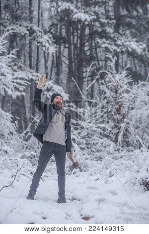 Bearded Man With Axe In Snowy Forest. Temperature, Freezing, Cold Snap, Snowfall. Man Lumberjack Wit