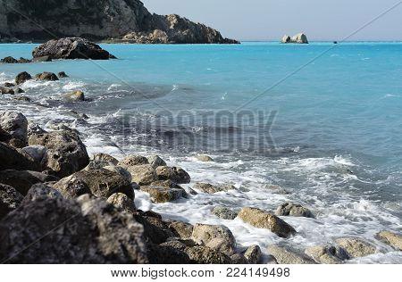 Stony coast of the Ionian sea in Greece. Tropical landscape paints. Blue sea