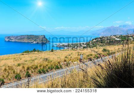 Beautiful sunshiny Calabrian Tyrrhenian sea coastline landscape and small rocky island Isola di Dino, Praia A Mare, Calabria, Italy