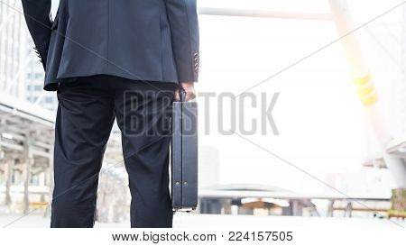Businessman holding a business briefcase.businessman holding briefcase and going to work time