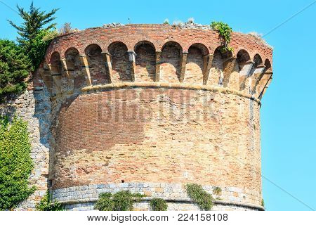 Fortification tower in Summer San Gimignano italian medieval village, UNESCO World Heritage Site, Siena province, Tuscany, Italy.