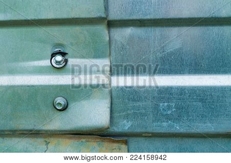 Industrial metal background. Corrugated zinc texture of metal fence, closeup of metal rough industrial surface. Zinc metal texture background, grunge metal industrial background