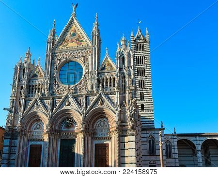 Siena Cathedral (Duomo di Siena), main facade completed in 1380. Siena is italian medieval town, capital of Siena province, Tuscany, Italy. Historic centre is UNESCO World Heritage Site.
