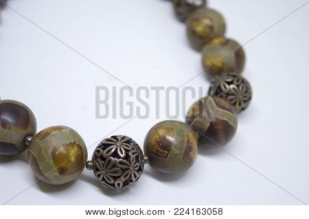 Original necklace with large round beads isolated on white background