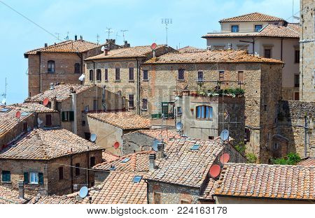 Summer ancient walled mountaintop town Volterra cityscape, Pisa province, Tuscany, Italy.