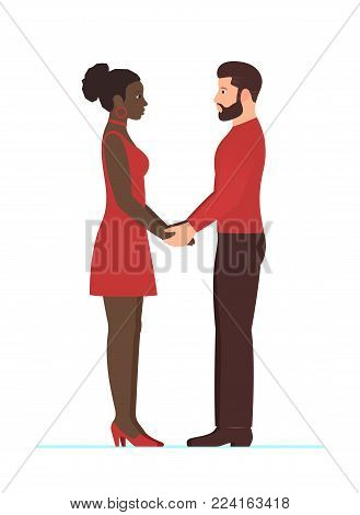Bearded white man and beautiful afro American woman. Happy multiracial couple in love, holding hands, looking into each others eyes, full growth standing. Happy Valentines day. Wedding or anniversary