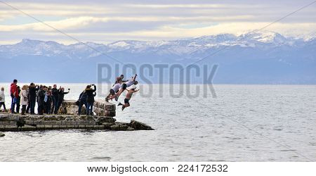 Ohrid, Macedonia - January 19, 2017: Men Jumping Into Freezing Water During The Celebration Of Epiph