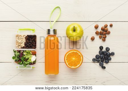 School lunch boxes for child. Top view on healthy snacks, fruits and vegetables for dinner meals out of home. Eating right and food storage concept, flat lay, copy space on white wooden background