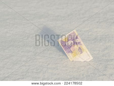 Banknotes of old Belarusian rubles samples withdrawn from circulation dropped down to the snow