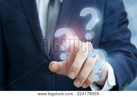 Businessman clicks on the question mark. The concept answers to the questions.