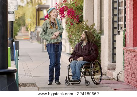 Woman talking with friend in a wheelchair