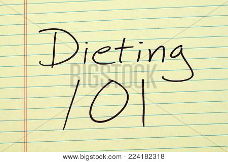 The words Dieting 101 on a yellow legal pad