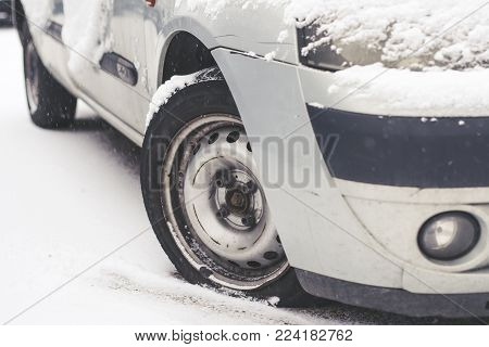 Close up wheel flat tire of the car in snow in winter