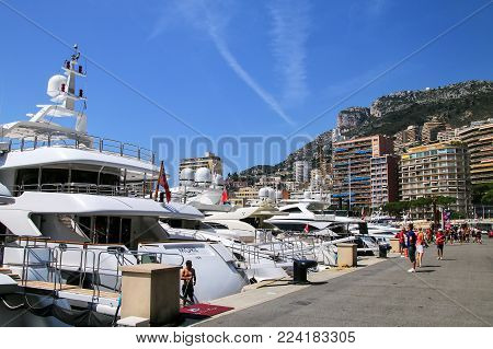 MONACO - JULY 11: Yachts docked at Port Hercules on July 11, 2015 in La Condamine ward of Monaco. Port Hercules is the only deep-water port in Monaco