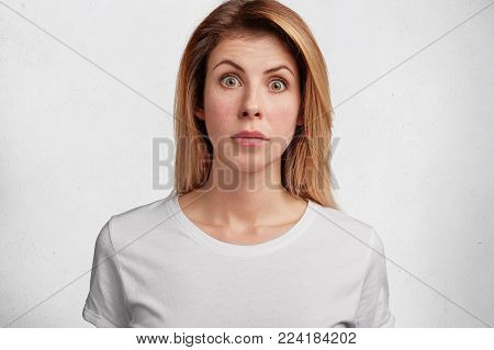 Oh No! Portrait Of Excited Female Model Being Shocked To Hear Bad News, Dressed Casually, Isolated O