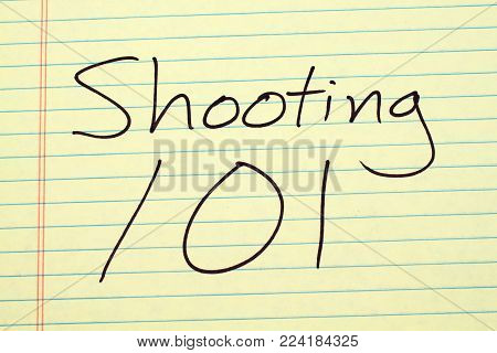 The words Shooting 101 on a yellow legal pad
